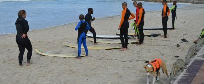 Projects Abroad volunteers being prepped to go out and surf during a lesson by our surfing coordinator